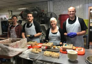 HHS Austin Office volunteers during lunch hour at local soup kitchen