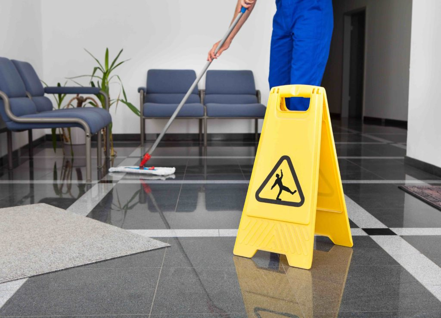 team member mopping