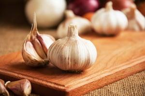 garlic on wood cutting board