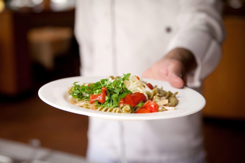 chef-blurred-holding-dish-798x532