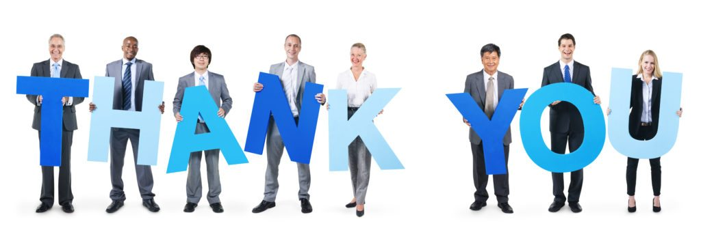 executives-with-thank-you-sign-cropped-1024x356