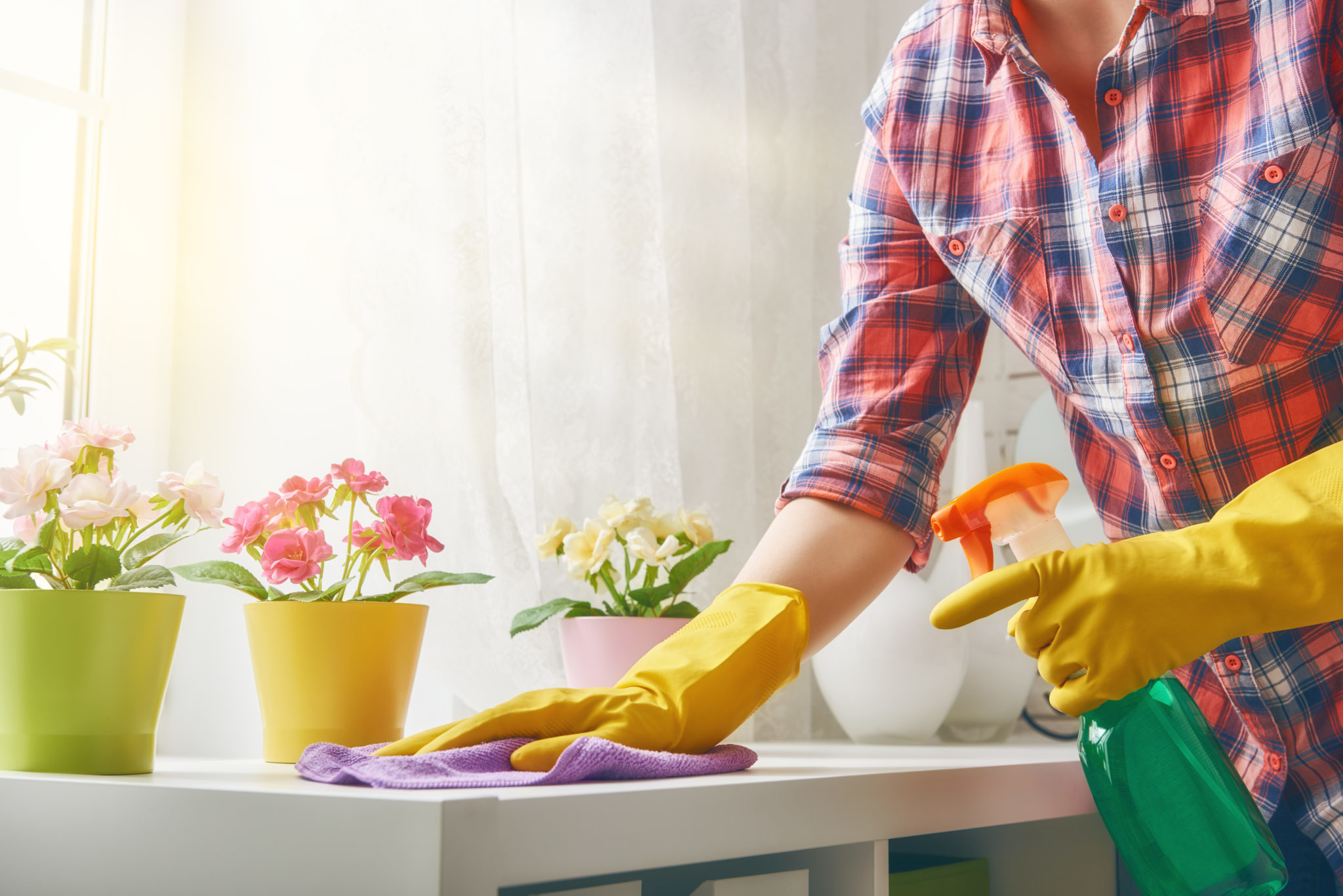 woman-spraying-clean-counter